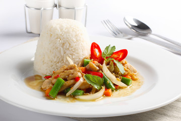 Thai spicy food, stir fried chicken whit basil on rice.