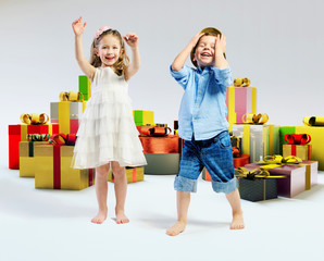 Happy kids with lots of gifts