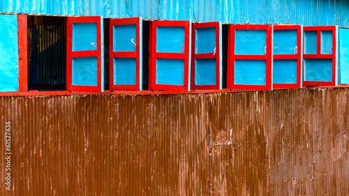 Red and blue wooden windows