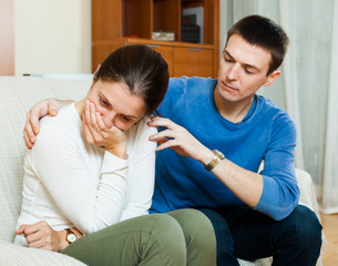 crying woman has problem, man consoling her