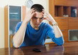 Man having disappointment after phone call