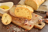 Fresh bread - ciabatta, chili and garlic on old wooden board