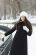 Cheerful Caucasian Young Woman in Snowy Weather