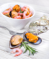 Mussels and shrimp in a white cup, seafood