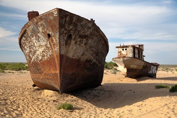 Boats in desert around Moynaq - Aral sea - Uzbekistan - asia