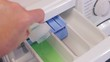 Putting detergent and softener in the washing machine