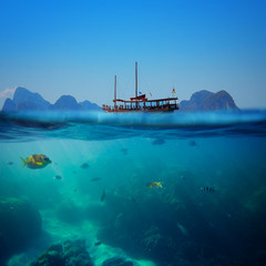 Tropical underwater shot splitted with ship and sky