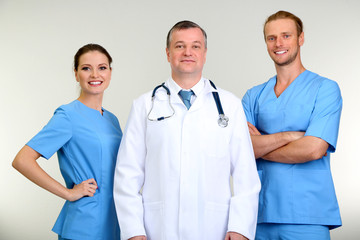 Medical workers on grey background