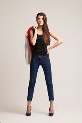 The beautiful young girl poses in studio. Clothes advertizing. C