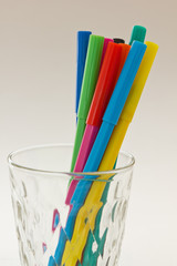 colorful pens in a glass