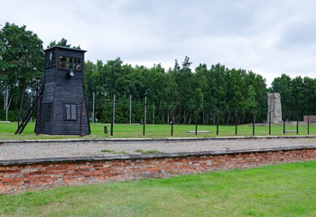 Barrack ruins and border tower in concentration camp Stutthof