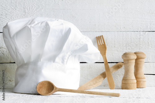 Chef hat and wooden kitchenware food abstract on white boards