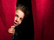 Leinwanddruck Bild - Child appearing beneath the curtain