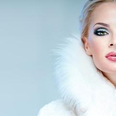 beautiful woman in a white fur coat