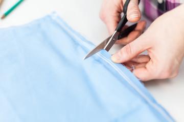 Scissors cutting tissue
