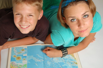 boy and girl read the map
