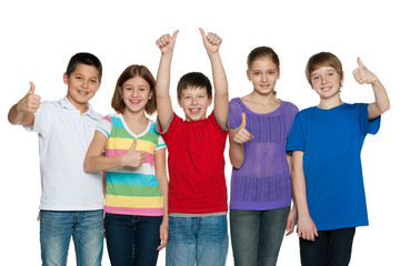Happy children hold their thumbs up