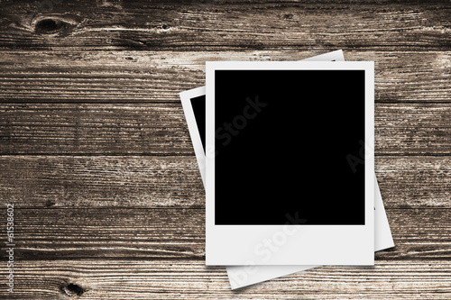 two Polaroid retro frames on wood texture - 61538602
