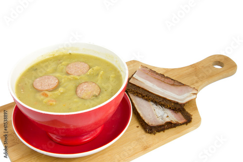 cutting board with soup bowl filled with so called erwtensoep