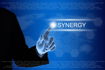 business hand clicking synergy button on touch screen