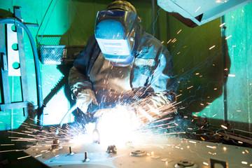 Welder worker during welding works