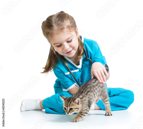 Kid girl playing doctor with cat kitten