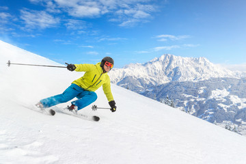 Male skier with mountains