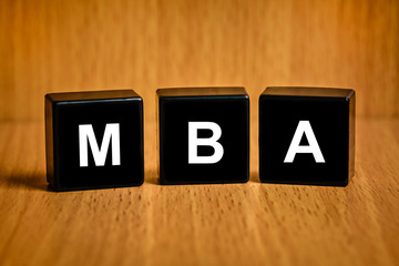 MBA or Master of Business Administration text on block