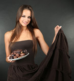 Portrait of beautiful young girl with chocolate sweets