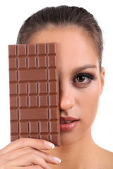 Portrait of beautiful young girl with chocolate isolated