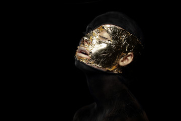 Fiction. Imagination. Futuristic Creature in Mystic Mask. Gilt