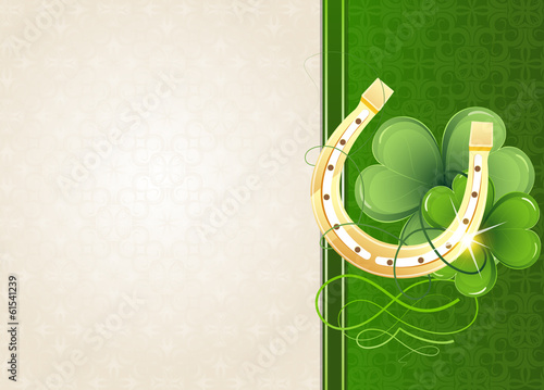 Horseshoe and clover on retro background