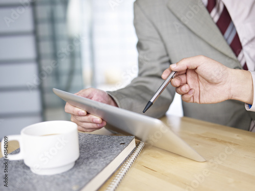 business persons using tablet in office