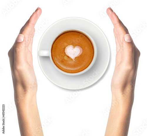 Latte coffee with heart symbol and woman hands isolated on white