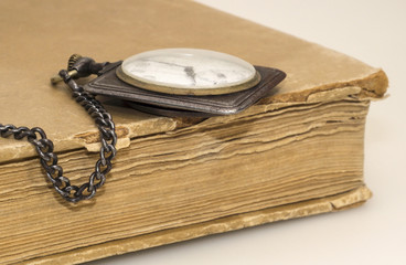 Old watch and tattered book