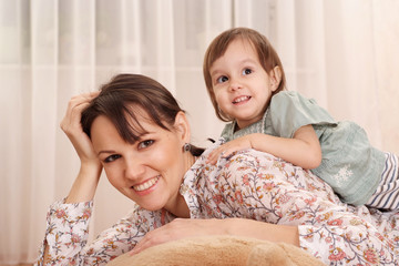 Portrait of a nice mom and daughter