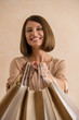 Portrait of happy smiling woman holding shopping bags