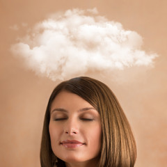 Close up of young woman with closed eyes and thought bubble
