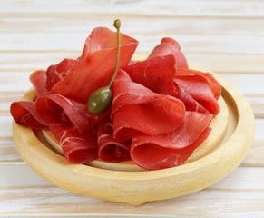 Smoked meat bresaola snack on a cutting board
