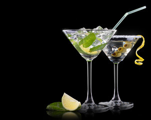 Cocktail martini and mojito on a black