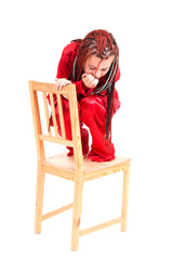frightened girl on the chair, white background
