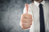 Businessman showing OK sign with his thumb up