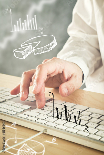 Businessman typing computer keyboard with pie chart and other in