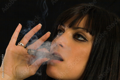beautiful girl smoking a cigar