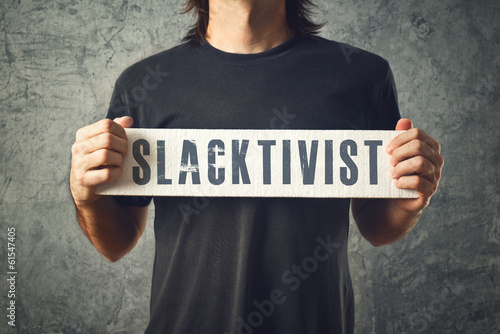 Man holding white banner with SLACTIVIST title