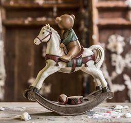 Vintage old rocking horse on a wooden background
