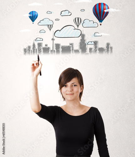 Pretty woman sketching cityscape with colorful balloons