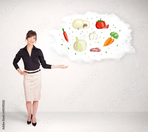 Young girl presenting nutritional cloud with vegetables