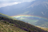 Rainbow in a mountain gorge.