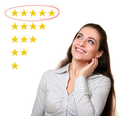 Beautiful woman looking up and choose five stars rating